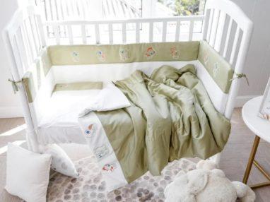 Белье в кроватку новорожденных